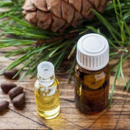 Cedarwood_pine_cones_and_oil.jpg